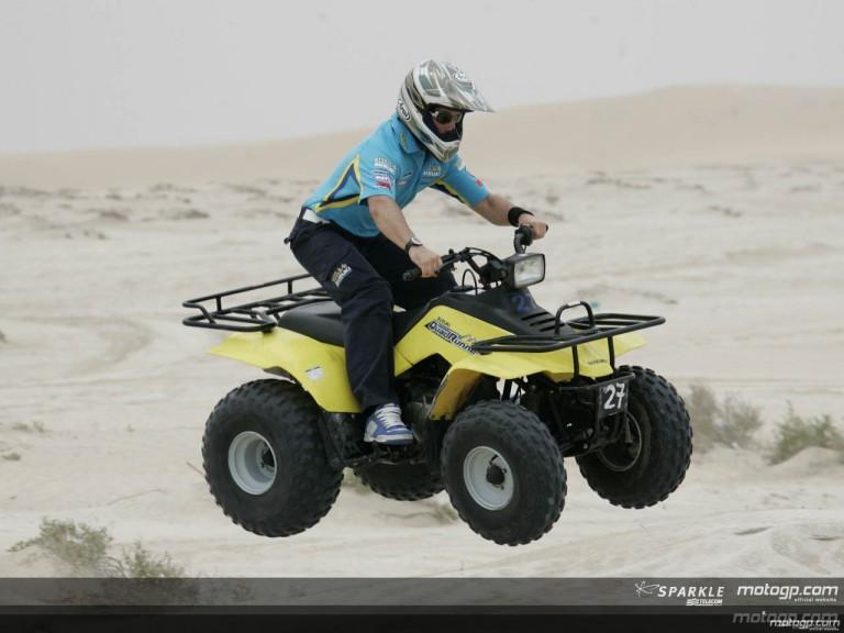 MotoGP riders drive quads