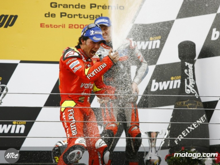 Toni Elias celebrates his MotoGP maiden win at Estoril in 2006