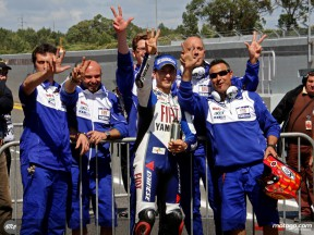 Lorenzo and his crew in the parc fermé at Estoril
