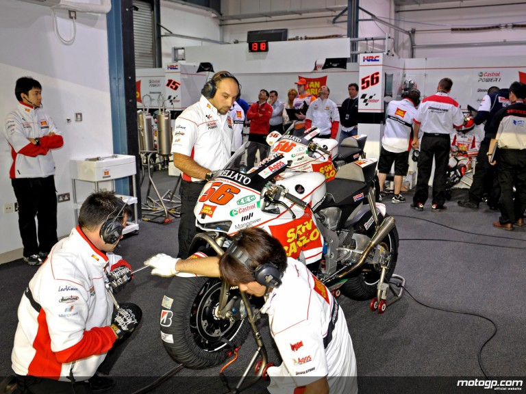 San Carlo Honda Gresini technicians work on Nakano´s bike
