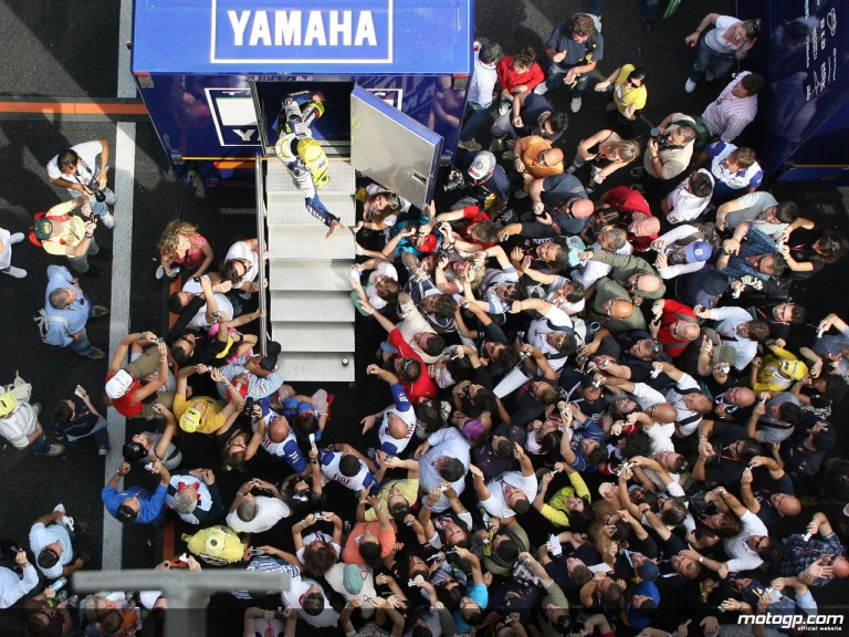Valentino Rossi greeted by his fans after qualifying at Mugello