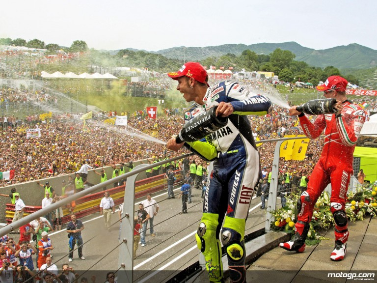 Valentino Rossi and Casey Stoner celebrating victory at Mugello