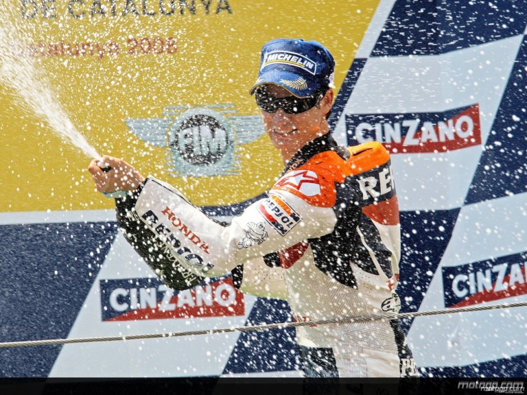 Dani Pedrosa celebrating his victory on the podium at Catalunya