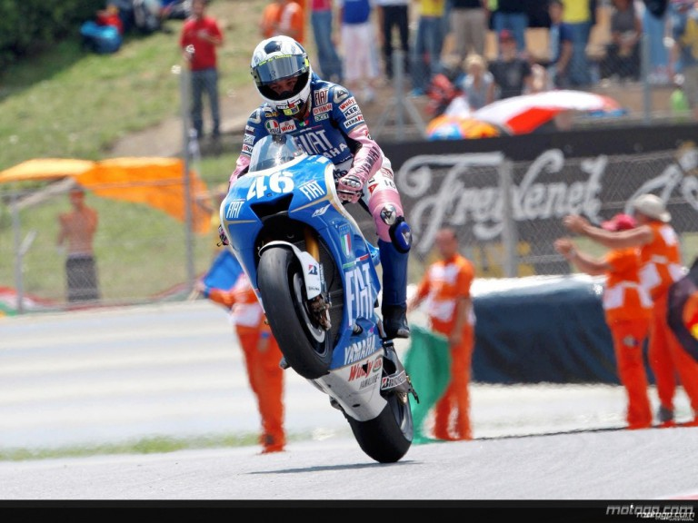 Valentino Rossi pulls off a wheelie after the race in Catalunya