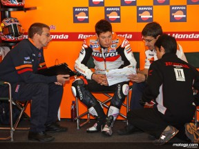 Repsol Honda rider Nicky Hayden with chief mechanic Pete Benson and his crew