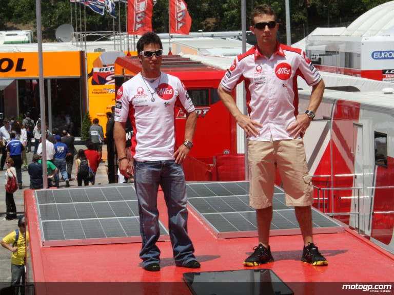Alice Team riders Elias and Guintoli on the team truck equipped with solar panels