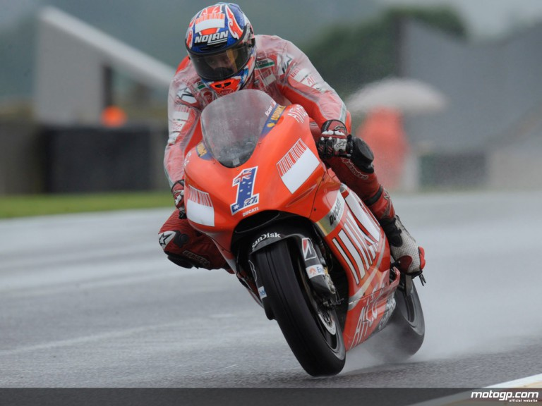 Ducati Marlboro´s Casey Stoner riding in the wet with special Alpinestars´ oversuit