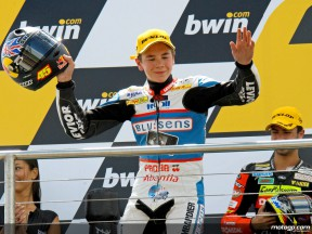 Scott Redding on the podium at Donington (125cc)