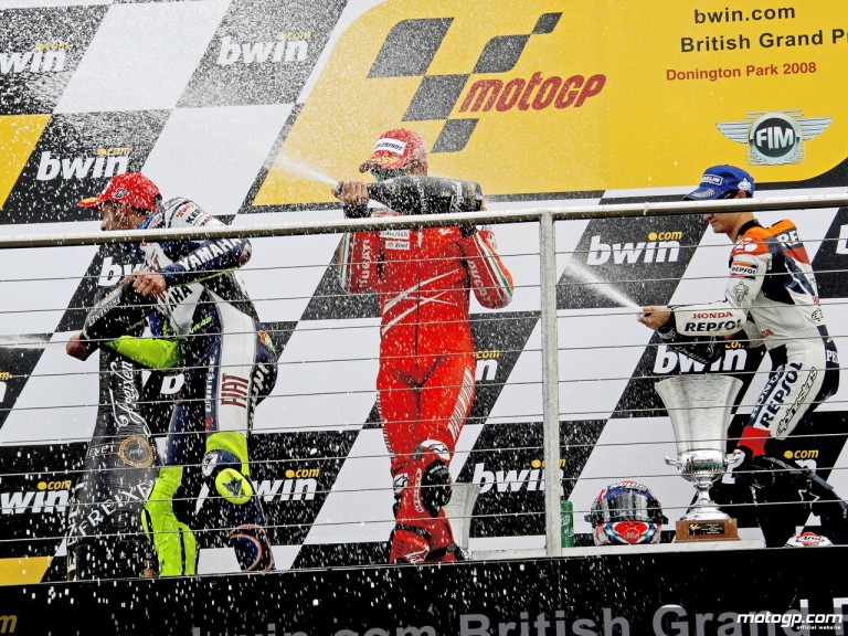 Rossi, Stoner and Pedrosa celebrating podium at Donington (MotoGP)