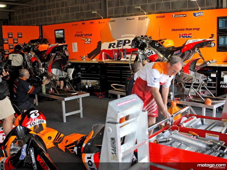 Repsol Honda staff at work in garage