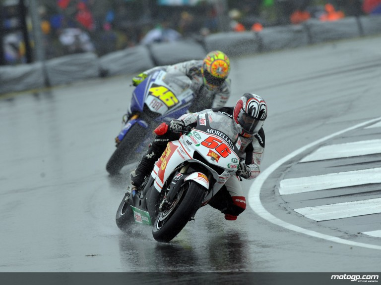 San Carlo Honda Gresini rider Shinya Nakano riding in the wet
