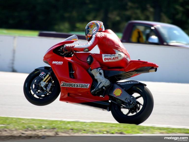 Niccolo Canepa of Italy shows the low-end torque of a Ducati MotoGP bike while accelerating into a wheelie during testing at IMS
