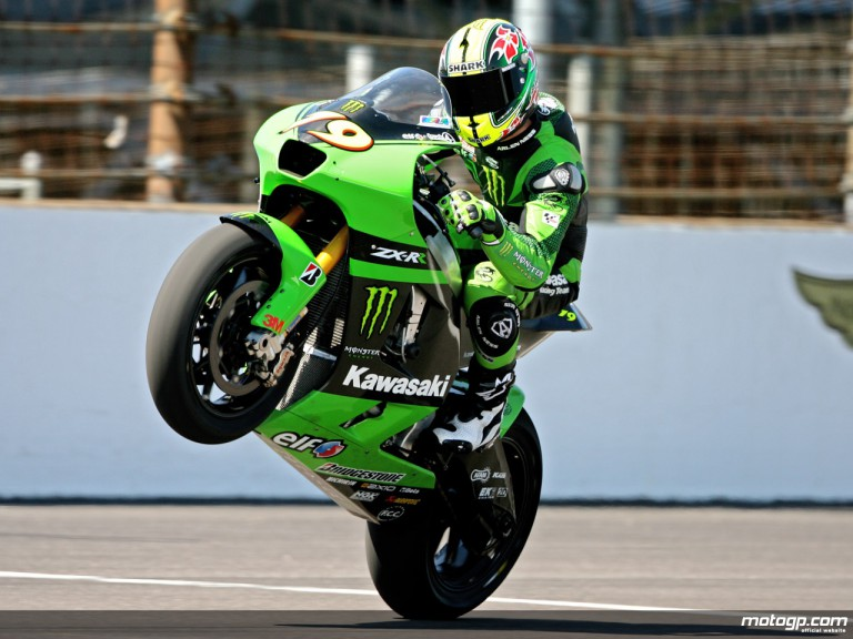 Olivier Jacque of France pulls a wheelie on his Kawasaki on the straightaway at IMS