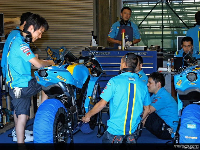 The Rizla Suzuki MotoGP team works on the bikes of Ben Spies and Nobuatsu Aoki