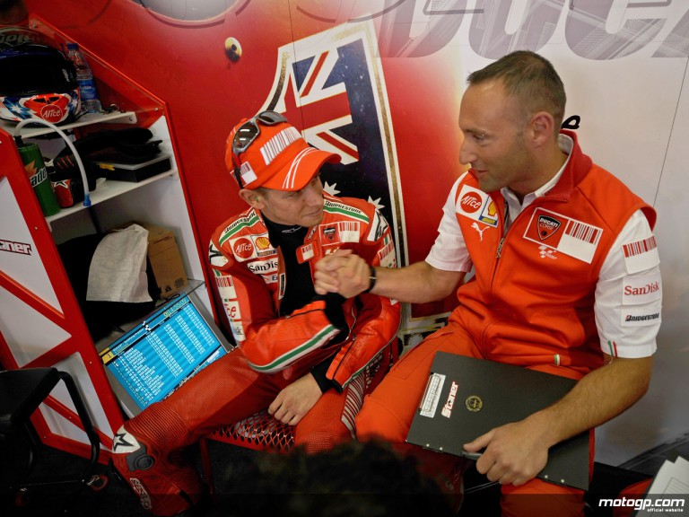 Casey Stoner and his race engineer Cristian Gabarrini in the Ducati Marlboro garage