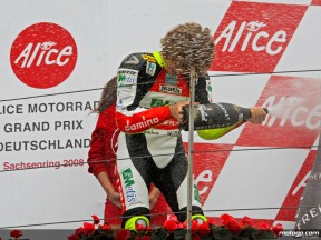 Marco Simoncelli on the podium at Sachsenring (250cc)