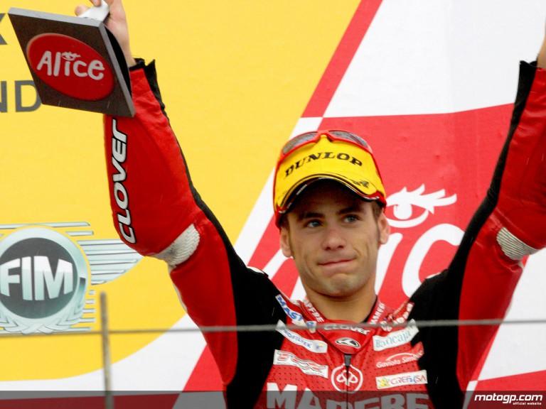 Alvaro Bautista on the podium at Sachsenring (250cc)