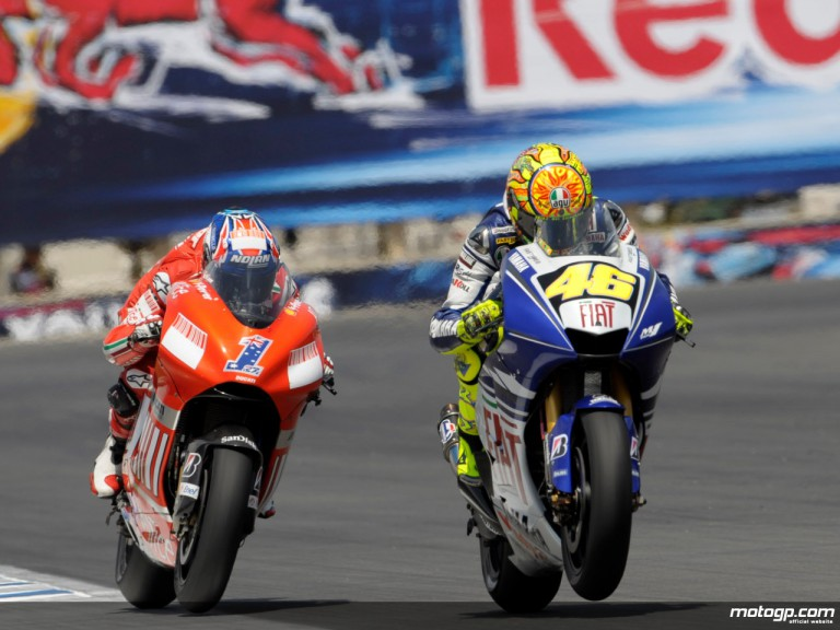 Casey Stoner and Valentino dicing for the lead at Laguna Seca
