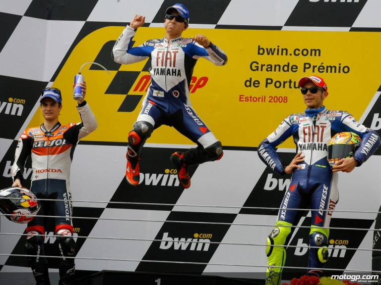 Jorge Lorenzo celebrates his first MotoGP win at Estoril ahead of Valentino Rossi and Dani Pedrosa