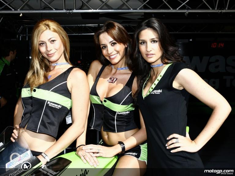 The Kawasaki Racing paddock girls posing in front of the team garage
