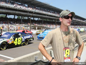 Colin Edwards on the pit barrier at Indianapolis for the start of NASCAR Allstate Brickyard 4000