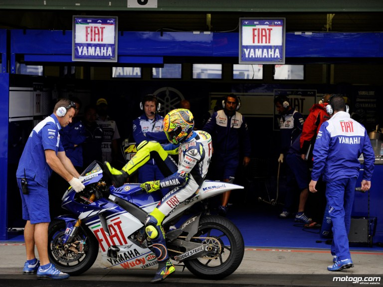 Valentino Rossi back to his Fiat Yamaha box