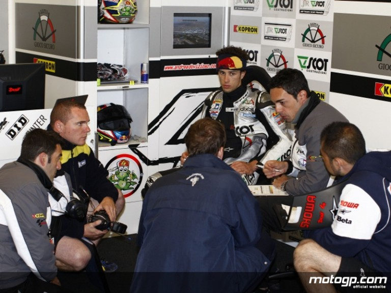 Andrea Dovizioso in the JiR Scot Team garage alongside chief mechanic Pietro Caprera and his technical staff