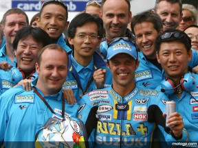 Loris Capirossi celebrates his first podium with Rizla Suzuki at the Brno circuit
