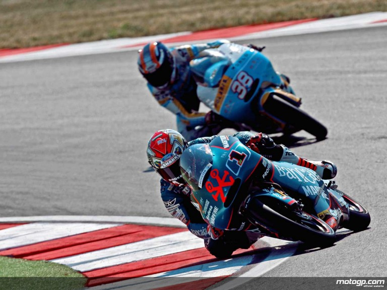 Gabor Talmacsi on his way to victory at Misano ahead of Bradley Smith