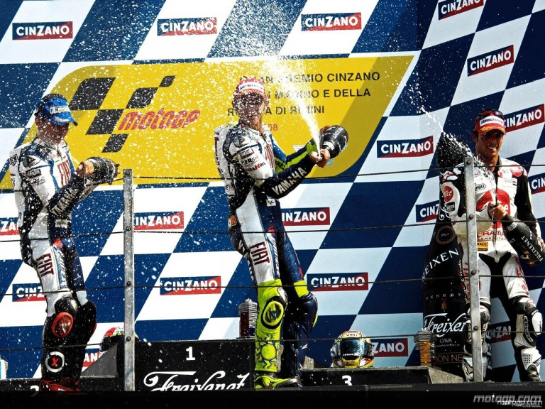 Lorenzo, Rossi and Elias celebrating victory on the podium at Misano