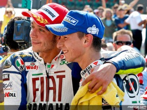 Yamaha riders Valentino Rossi and Jorge Lorenzo celebrate their podium finish in Misano