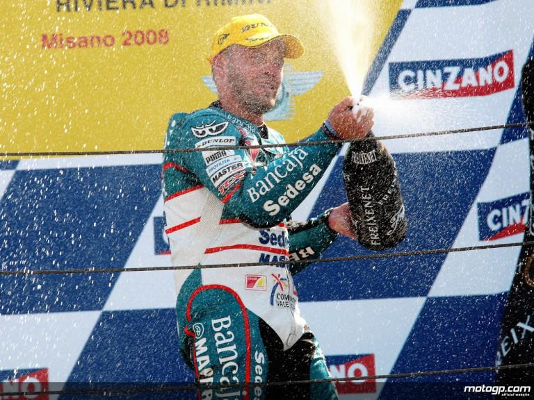 Gabor Talmacsi celebrating podium at Misano (125cc)