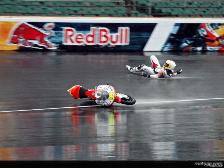 Romanian rider Robert Muresan crashes in the first practice session at Indianapolis
