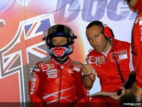 Casey Stoner and his race engineer Cristian Gabarrini in the Ducati garage