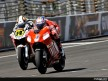 Casey Stoner riding ahead of Randy de Puniet during Qualifying Practice at Indianapolis