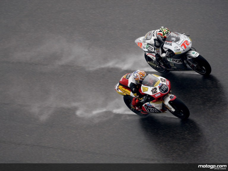 Luthi and Takahashi battling on a rainy track