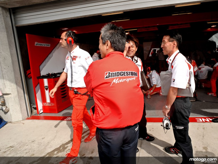 Bridgestone staff in front of the Ducati garage