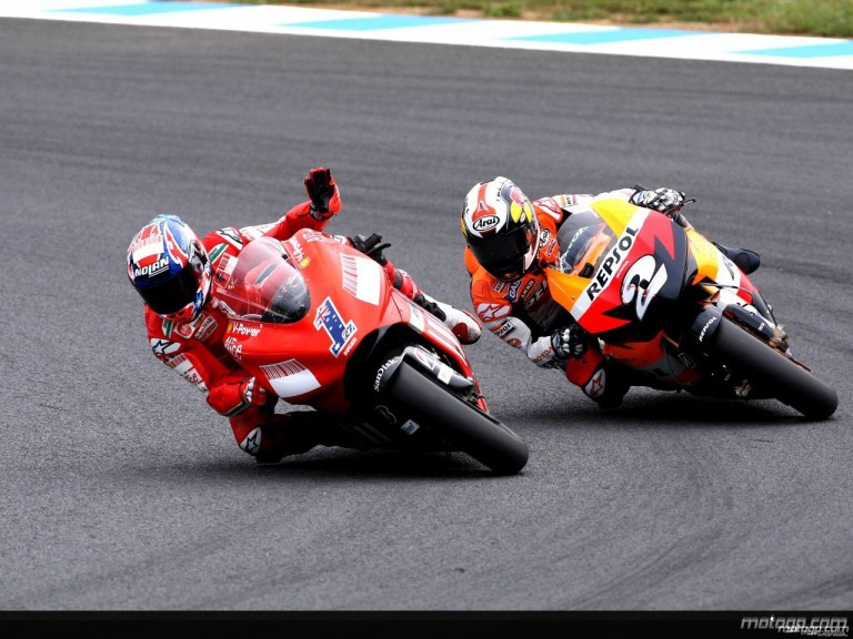 Casey Stoner and Dani Pedrosa in action in Motegi