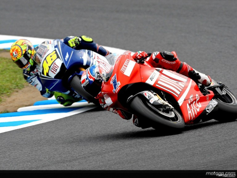 Casey Stoner and Valentino Rossi in action in Motegi