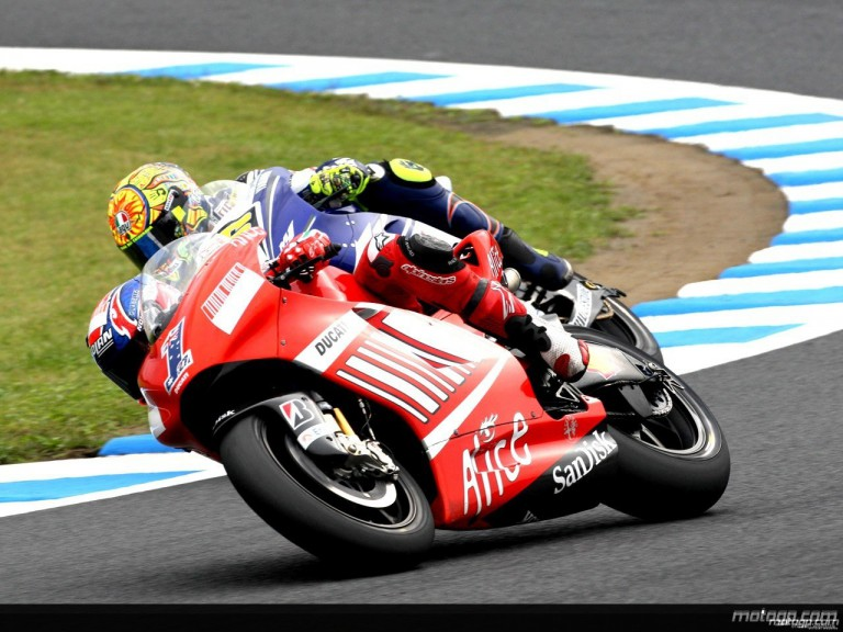 Casey Stoner riding side-by-side with Valentino Rossi in Motegi