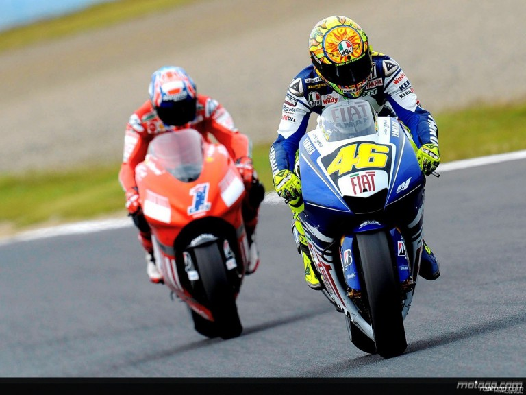 Valentino Rossi riding ahead of Casey Stoner in Motegi