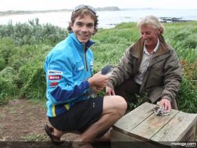 Chris Vermeulen releases a penguin at Phillip Island