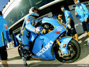 Loris Capirossi in front of the Rizla Suzuki garage