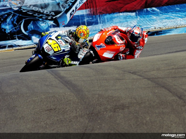 Valentino Rossi riding side by side with Casey Stoner