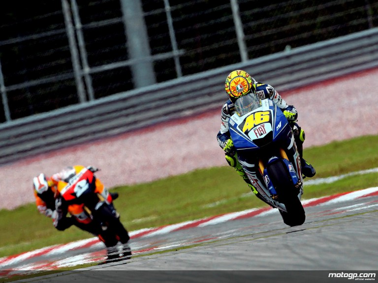 Valentino Rossi riding ahead of Dani Pedrosa in Sepang