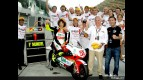 Simoncelli celebrates his 250cc World title with the Metis Gilera team