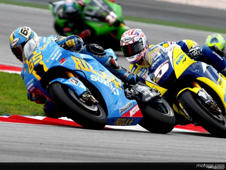 Loris Capirossi and Colin Edwards in action in Sepang
