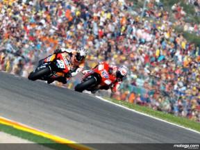 Dani Pedrosa riding ahead of Casey Stoner in Valencia, 2007