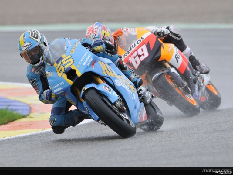 Loris Capirossi riding ahead of Nicky Hayden during Practice in Valencia