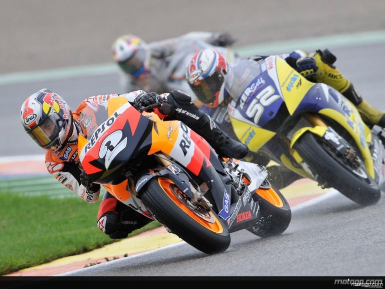 Dani Pedrosa riding ahead of James Toseland during Practice in Valencia
